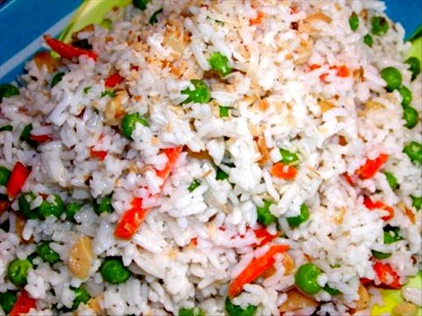 Coconut Rice Erupting With Spices, Nuts & Peas. Photo by Rita~