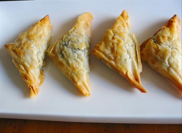Kittencal's Greek Spinach and Feta Puff Pastry Triangles. Photo by Caroline Cooks