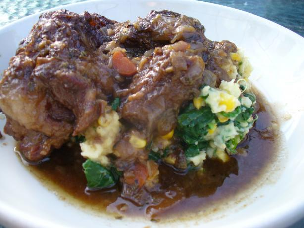 Smothered Oxtails over Spinach and Sweet Corn Mash. Photo by IngridH