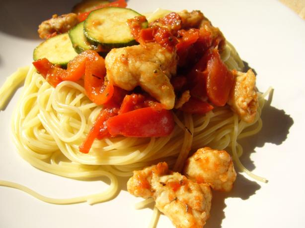 Chicken With Peppers, Zucchini and Tomatoes on Angel Hair. Photo by cookiedog