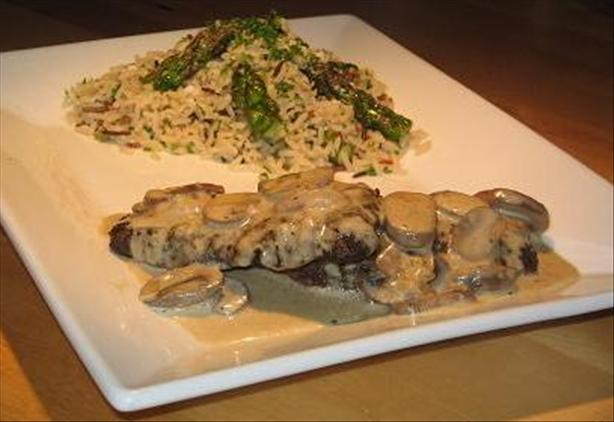 Ostrich Steaks With Mushroom Vanilla Sauce and Wild Rice With As. Photo by The Flying Chef