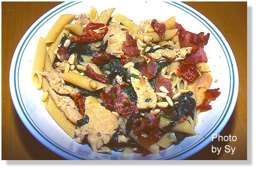 Pasta With Chicken, Spinach, Pine Nuts, Bacon And. Photo by Skipper/Sy