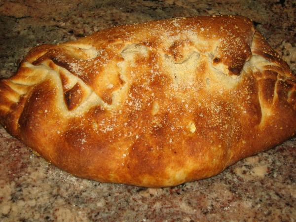 Sausage and Pepperoni Cheese Stuffed Calzone. Photo by Super San Mateo Chefs