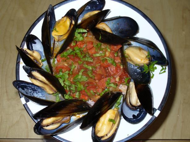 Steamed Clams With Chorizo and Tomatoes. Photo by IngridH