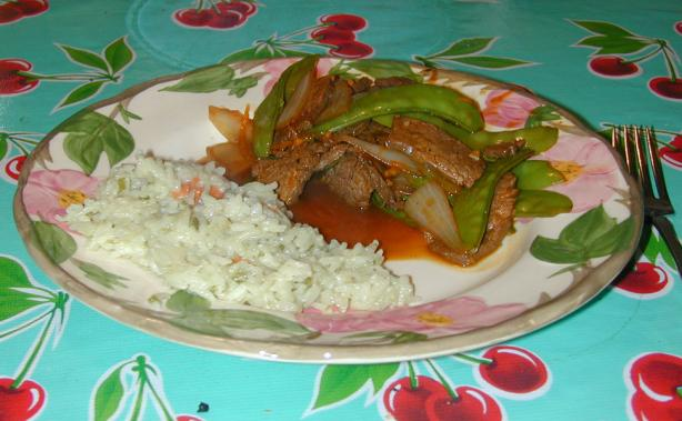 Tangerine Stir-Fried Beef With Onions and Snow Peas. Photo by MaryMc