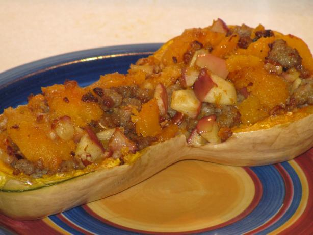Baked Butternut Squash Stuffed With Apples and Sausage. Photo by Shelby Jo