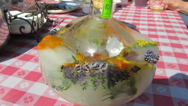 Frozen Festive Vodka or Tequila Bottles With Herbs and Berries. Photo by Rita~