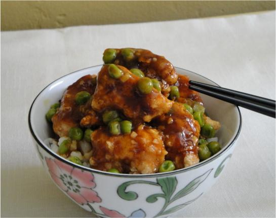Restaurant Style Chinese Orange Chicken With Spring Peas. Photo by Debbwl