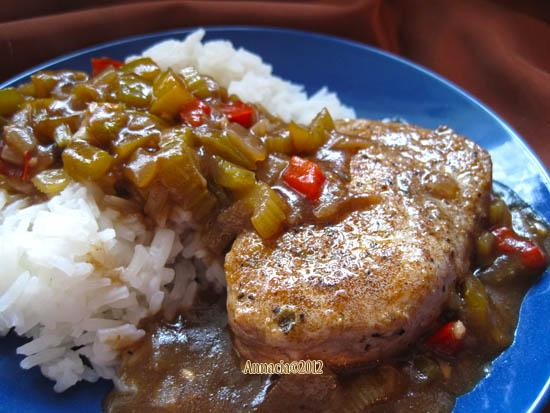 Cajun Smothered Pork Chops. Photo by Annacia