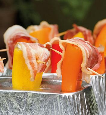 Mini Peppers Stuffed With Cheese and Topped With Bacon - Grilled. Photo by Viclynn