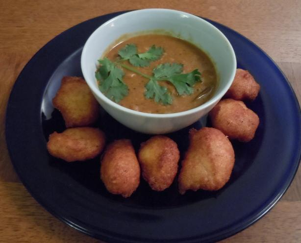 Sambhar Vada  (Yellow Lentil Soup With Spiced Doughnuts). Photo by alvinakatz