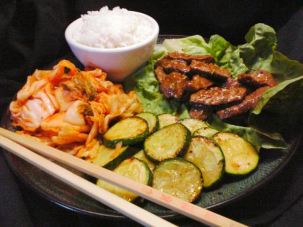Bulgogi (Korean Beef) with rice and lettuce. Photo by 2Bleu