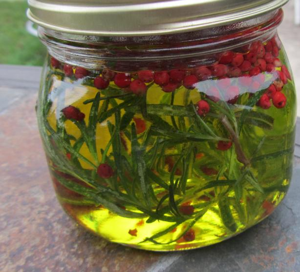 Olive Oil with Rosemary and Pink Peppercorns. Photo by Rita~