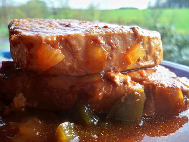 Spicy and Tender Crock Pot Pork Chops. Photo by Lainey6605