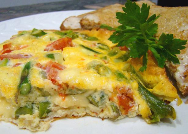 Frittata with Asparagus, Tomato, and Fontina. Photo by Derf