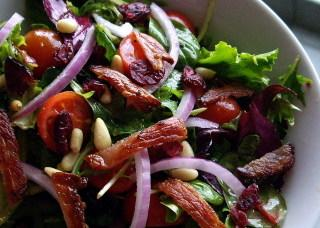 Garden Salad With Cranberries, Pine Nuts, and Bacon. Photo by AmandaInOz