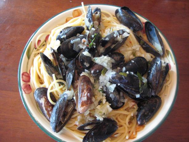 Garlicky Mussels in a Rich Lemon, Fresh Herb, Butter Sauce. Photo by RedVinoGirl